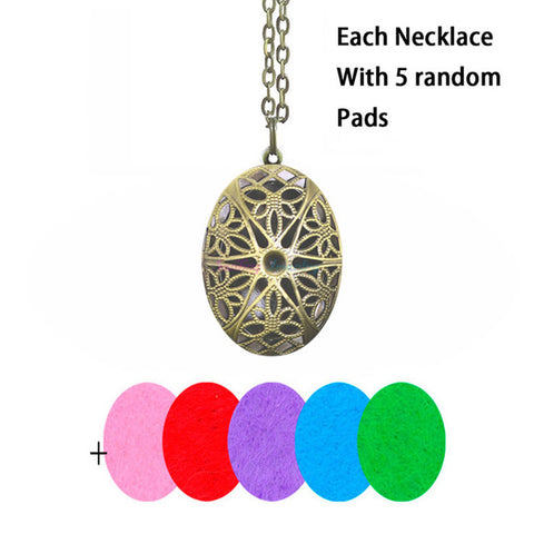 Image of Brass Heart Flower Pattern Diffuser Necklace