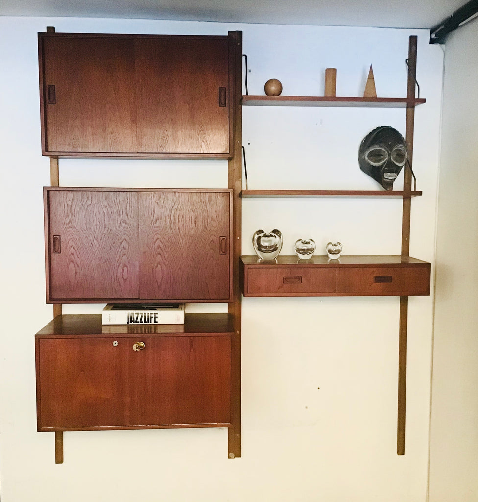 Danish Mid Century wall Shelving by Poul Cadovius