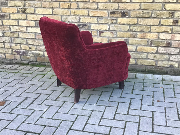Small vintage upholstered armchair