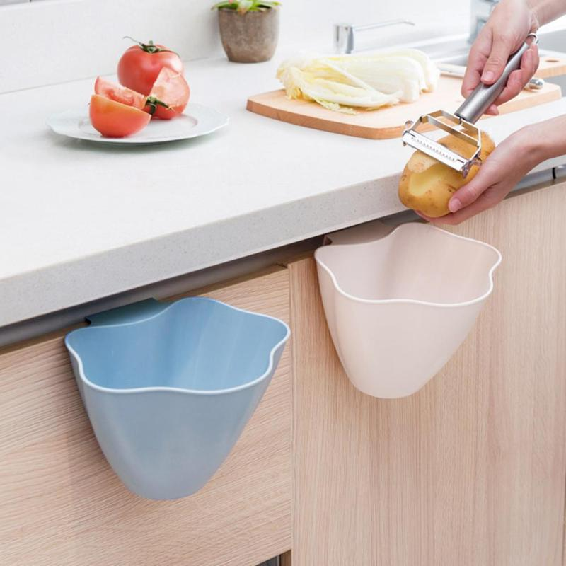 This cabinet door trash bin allows for easy and clean food prepping in the kitchen. You can now cook clean as you go with this sleek cabinet door trash bin.