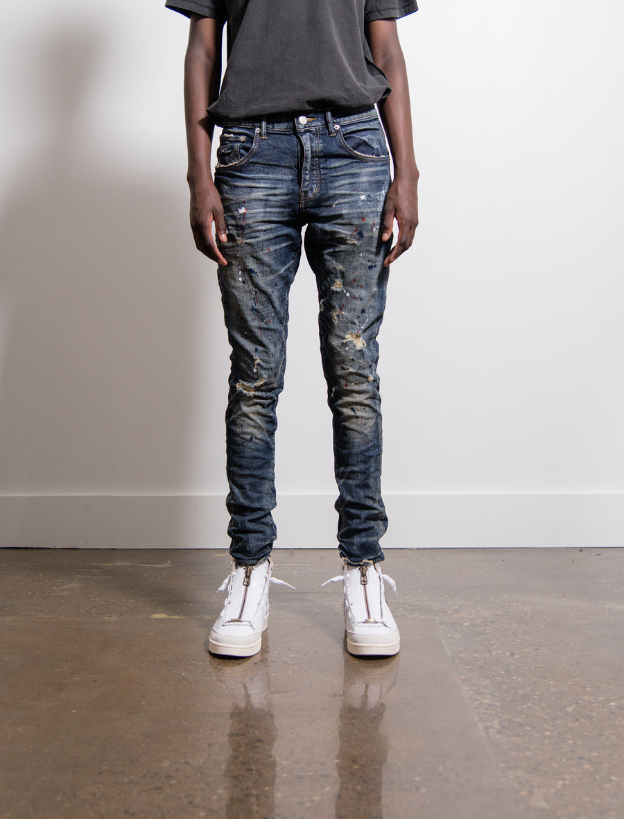 002 Dropped Fit Mid Rise Tapered Jean Vintage Dirty Distress Indigo