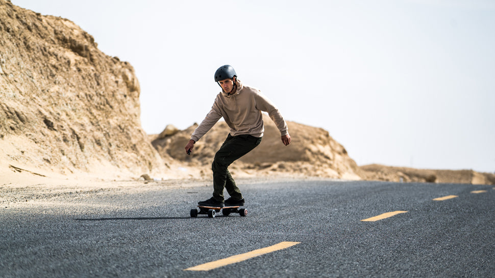 A man riding LycaonBoard Electric Skateboard
