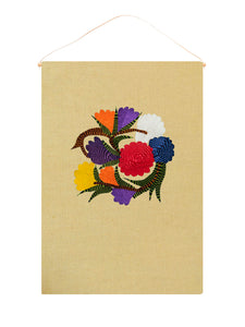 Unity flower wall hanging on light yellow linen