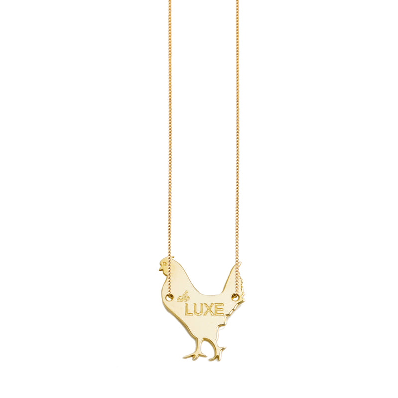 "necklace with a ""luxury hen""."
