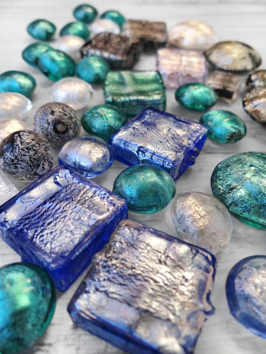 Examples of Murano Glass beads sommerse with silver leaves.