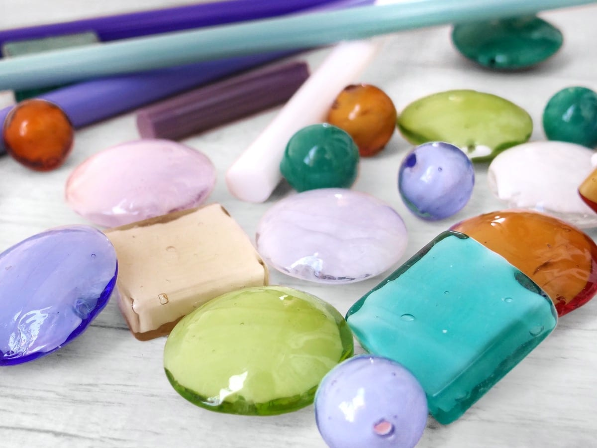 Examples of pastel Murano Glass beads, made with the lampworking technique