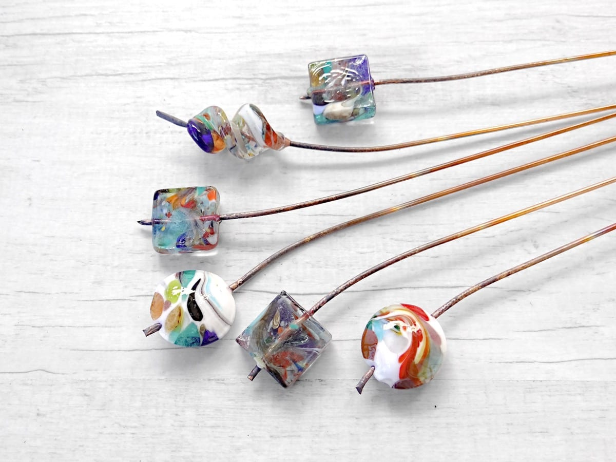 Murano Glass beads still attached to the copper sticks.
