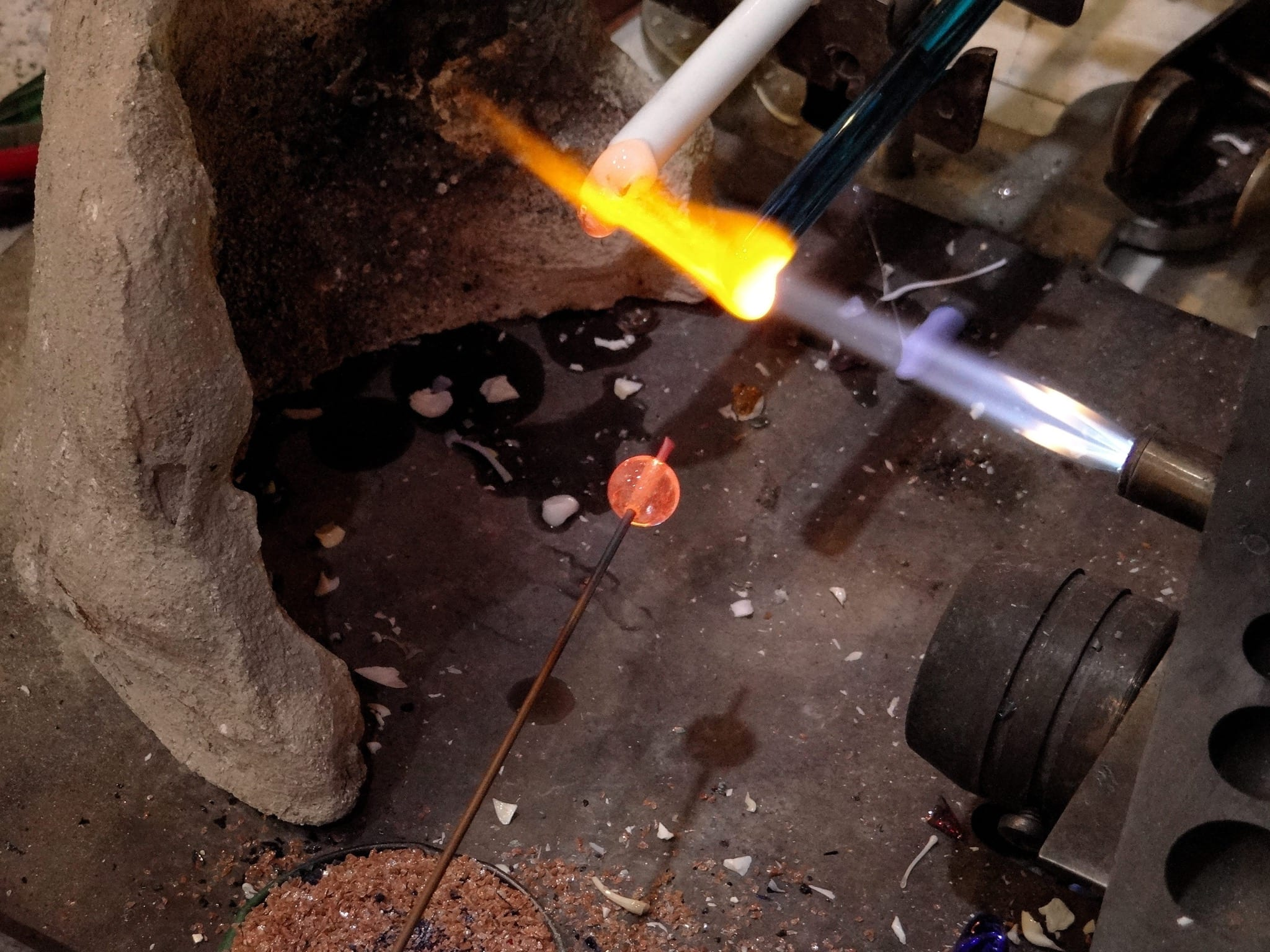Murano Glass lampwork beads - the glass rod is melted over the copper stick