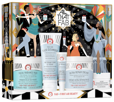 Lithe Lashes Blog Holiday Gift Ideas showcasing First Aid Beauty Skincare bundle from Sephora website. Includes facial pads, face cleanser, lip therapy, dry skin cream. 1920's style dancers on the gift box holding christmas presents and dancing