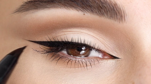 Close up of a fox eye makeup look with a touch of eyeliner in the inner corner