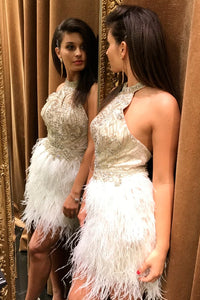 JOVANI SLEEVELESS IVORY HALTER TOP  WITH FEATHER BOTTOM. OPEN BACK.