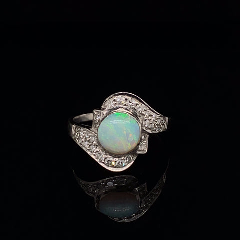 Vintage Platinum Ring featuring a bezel set Round Opal Cabochon with 28 single cut diamonds wrapping the opal in a curved fashion down the arms. Art Deco quality. Size 6.5