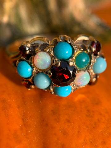 Vintage Magnality's Gumball Vintage Ring featuring Opals, Garnet, and Turquoise gemstones.