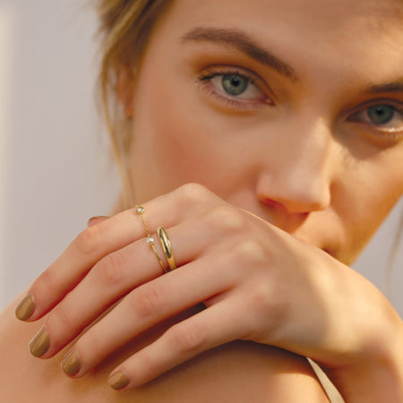 Model is wearing the 6MM style in 14K Yellow Gold 302® Fine Jewelry as seen in Harper's Bazaar Magazine