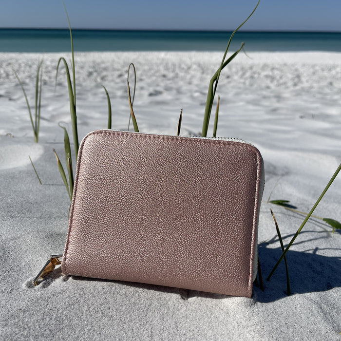 Our Blush Jewelry Travel Case Shown at the beach landscape position