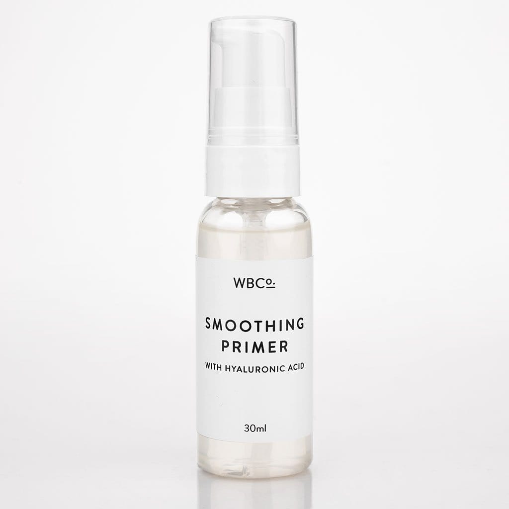 A clear bottle of skin primer, a clear gel-like liquid, stood against a white background