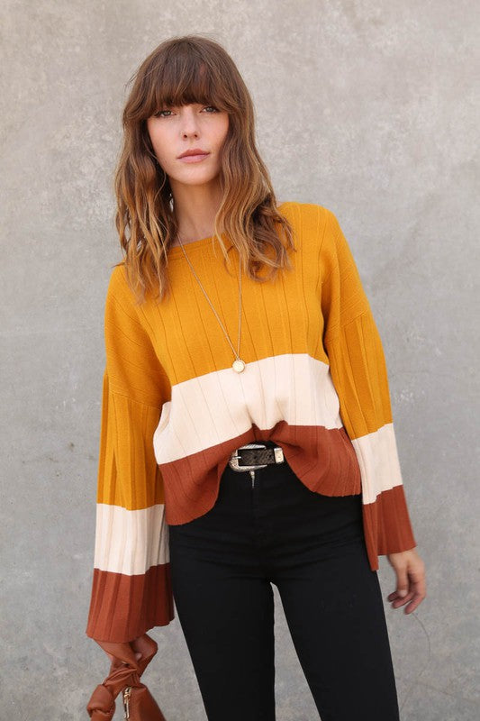 Color block accordion pleat sweater