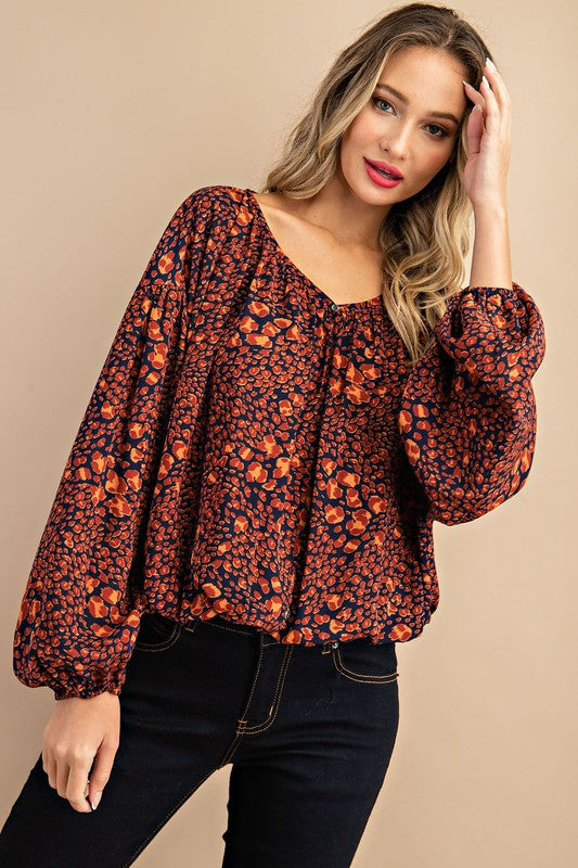 Leopard print pleated puff sleeve blouse