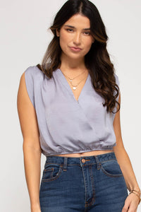 Padded shoulder sleeveless surplice crop top