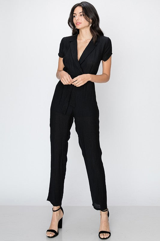 Surplice v neck jumpsuit with belt