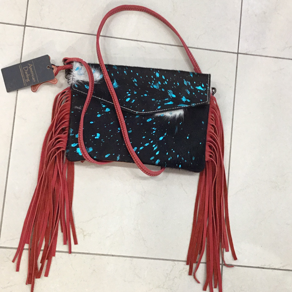 fur on cowhide envelope cross body fringe bag