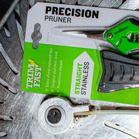 a GreenBroz machine trimmer with a pair of Hydrofarm Precision Pruners