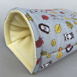 Grey and yellow woodland animals cosy snuggle cave. Padded stay open snuggle sack. Hedgehog bed. Fleece pet bedding.