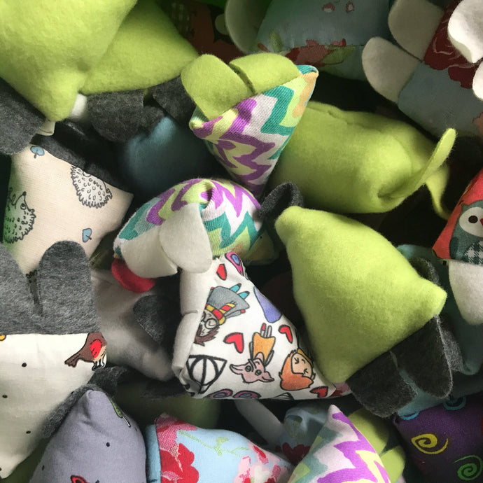 Fleece triangle toy. Hedgehog toy. Jingle bell toy in various mixed colours. Small pet toys.