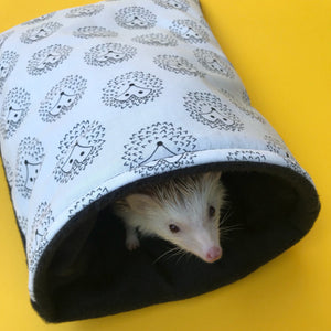 The Hoghouse black and white hedgehog cosy snuggle cave. Padded stay open hedgehog bed.