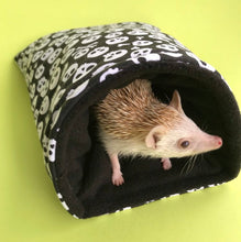 Load image into Gallery viewer, Black and white skull cosy snuggle cave. Padded stay open snuggle sack. Hedgehog bed.