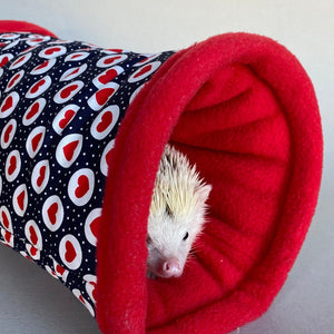 Red heart on navy stay open tunnel. Padded fleece tunnel for hedgehogs and small pets.