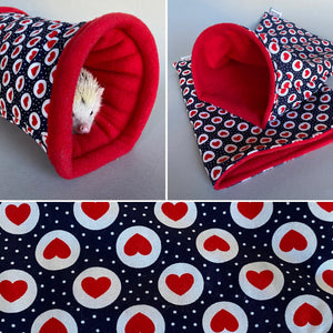 Red heart and navy mini set. Tunnel, snuggle sack and toys. Fleece bedding.