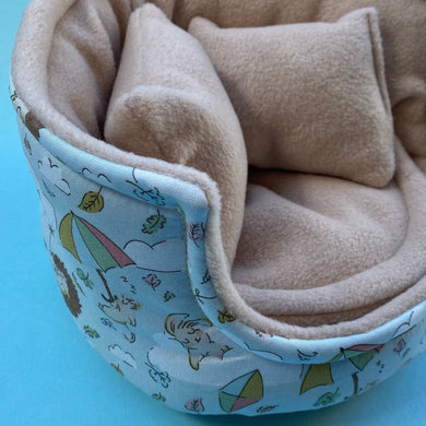 Blue Kite Hedgehog cuddle cup. Pet sofa. Small pet beds. Fleece sofa bed.
