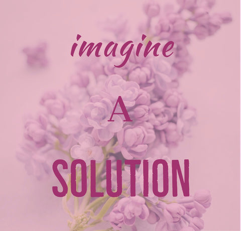 Slogan Imagine a Solution on a faded floral background