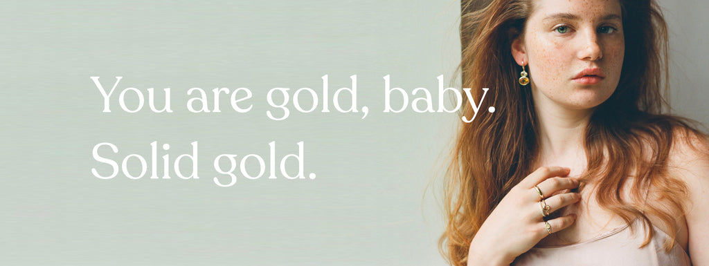 Text: You are gold, baby. Solid gold. Image: Beautiful girl wearing gorgeous jewelry.