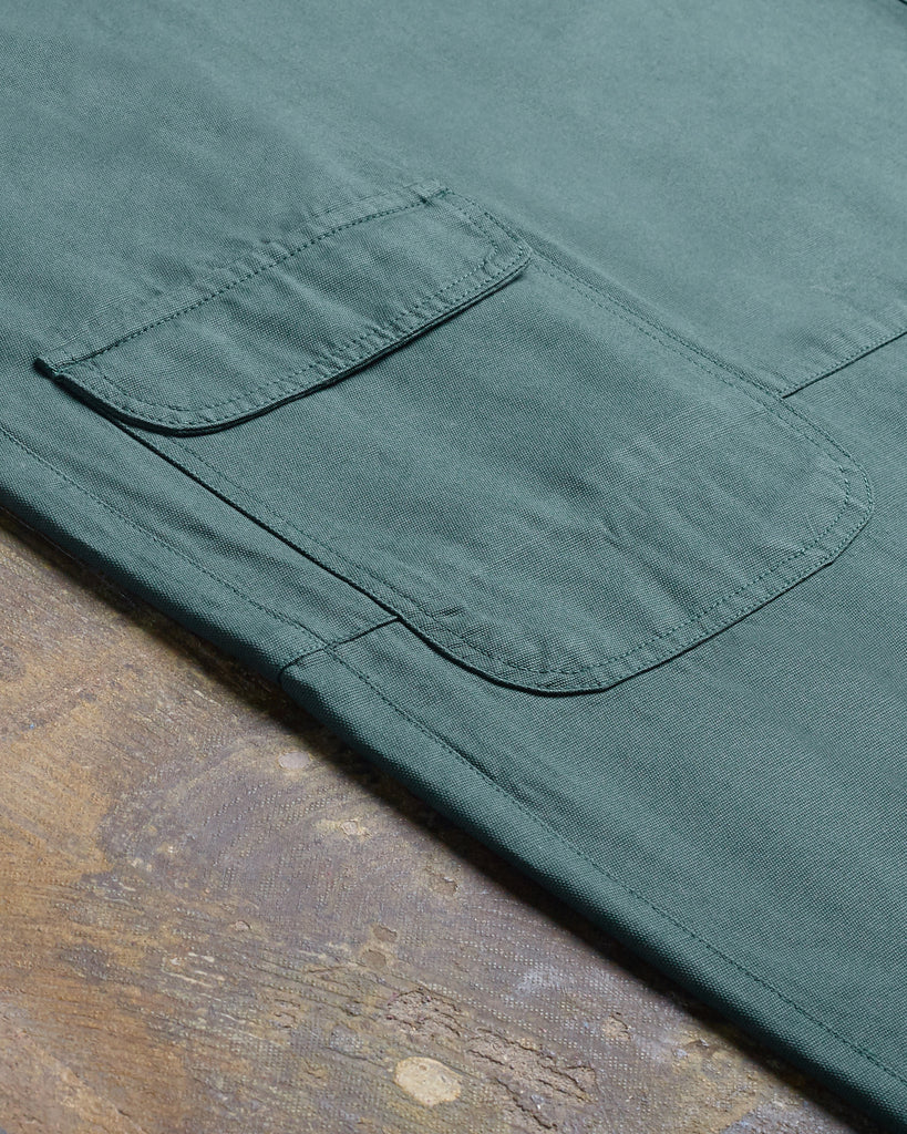 Close-up of pocket on green-coloured Uskees organic cotton garment.