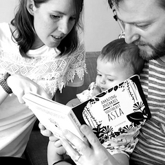 family reading together with baby
