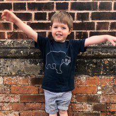 boy in sun bear tshirt