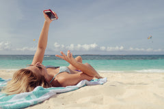 Girl In Bikini Taking Selfie On The Beach
