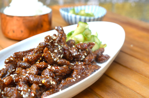 Crispy chilli beef with pickled cucumber and jasmine rice