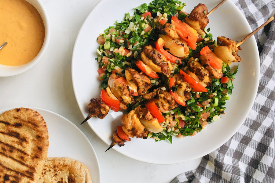 Harissa chicken skewers with tabouli and pita