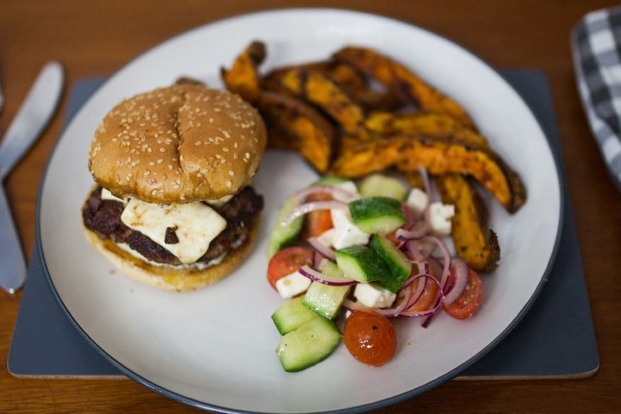 Lamb and feta cheeseburgers with minty aioli, wedges and Greek salad