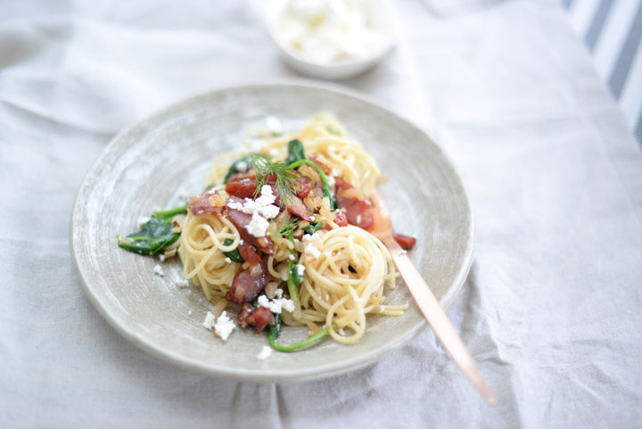 Spaghetti with smoked sausage, spinach and feta