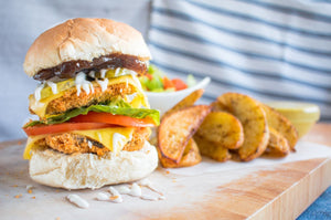 Vegan double portobello mushroom cheeseburgers with wedges and side salad