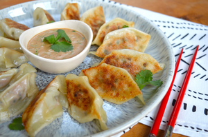 Easy potsticker dumplings with a tamarind and peanut dipping sauce