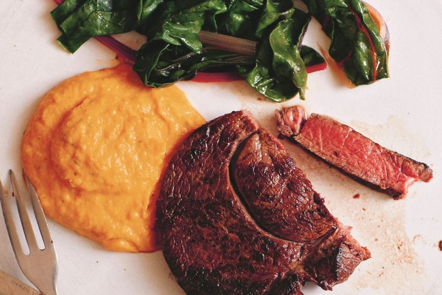 Venison steak with butternut squash purée and rainbow chard
