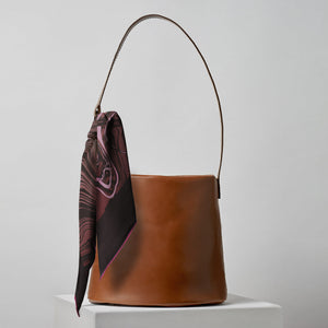 Silk twill Marbré scarf in merlot Burgundy and 706 Bucket Bag Handbag in cinnamon brown