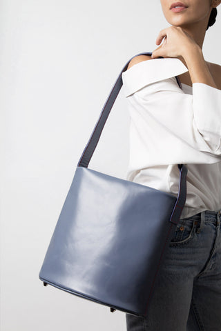 Women wearing MLE Leather 706 Bucket Bag Cadet Blue