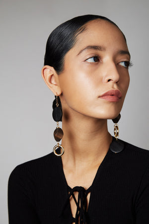 The MLE Caldo Earrings Shown on Model