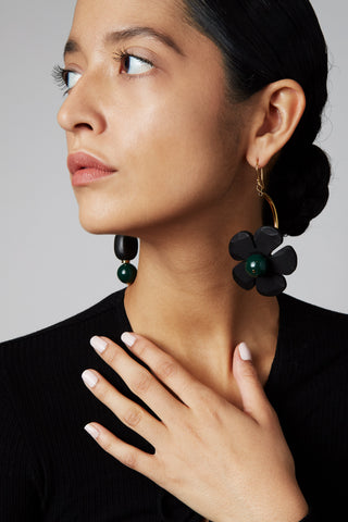 The handmade Fiore earrings shown on model